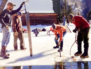 Pulling ice blocks from the lake
