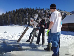 Ice cutters make blocks for the Creede Ice Sculpture Contest, as part of Cabin Fever Daze