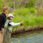 fishing guide helps guest set for the rainbow trout catch