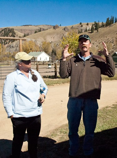accomplished photographer speaks to class in front of colorado ranch barn