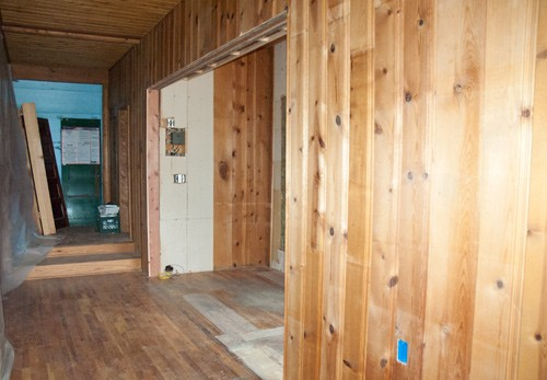bead bord and wood walls with large open reception area at colorado guest ranch