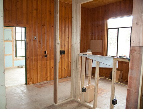 new office space at colorado guest ranch famed in with wood walls and bead board