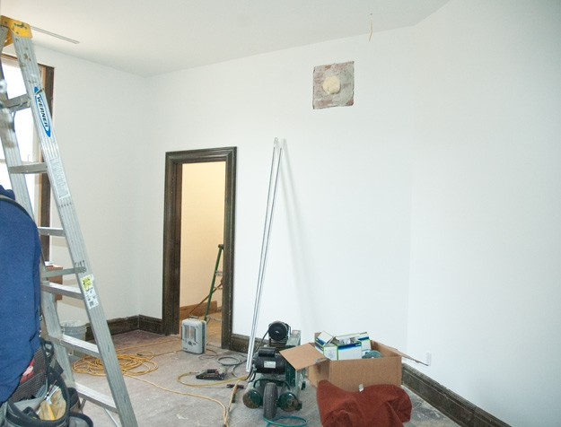 new drywall and white painted art studio inside old historic bathhouse