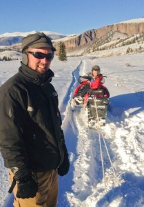 Smiling Brady Gibbons takes young son on Colorado snowmobile adventure!