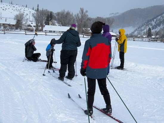 Everyone watching as the instructor demonstrates how to get up after falling on XC skis