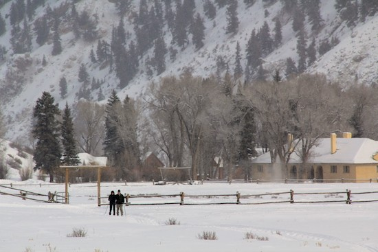 A couple XC skiing in the 4UR Ranch pasture along groomed tracks