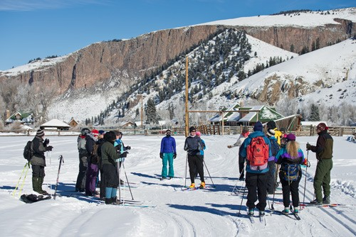 cross country ski instructor talks to group of men and women