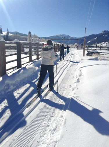 skiier starts out on colorado guest ranch groomed trail