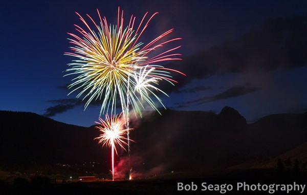 fireworks light up evening sky aove the small arts town of Creede Colorado
