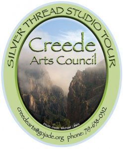 creede arts council studio tour logo. Creede cliffs in mist surrounded by a green oval with creede arts council name and webpage