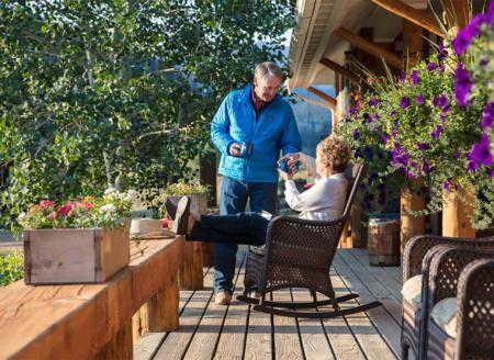 Couple relaxing on cabin deck