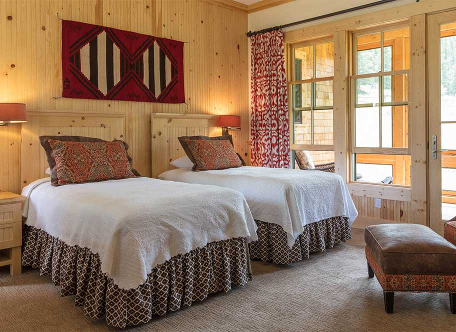 Two beds and sunny windows and doorway
