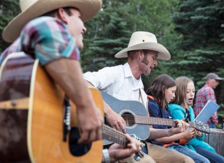 4UR Ranch hands singing with the kids