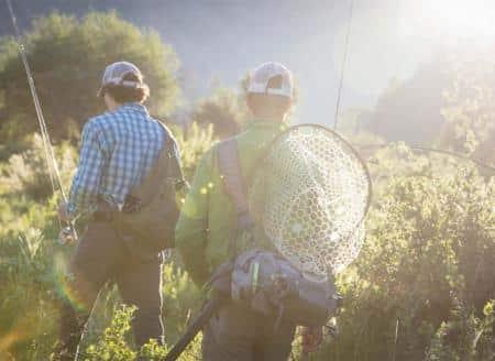 Fishermen walking to river