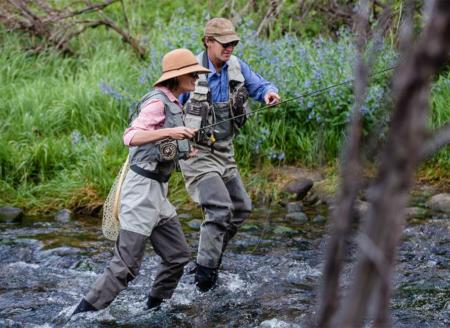 Fly fishermen walking in the river