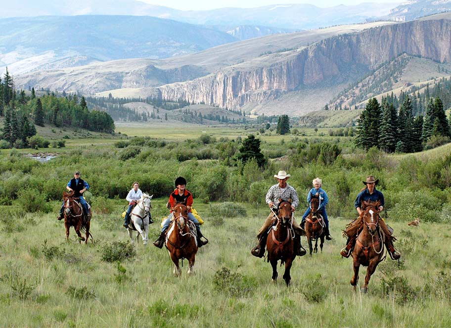 Riding group with scenic back drop