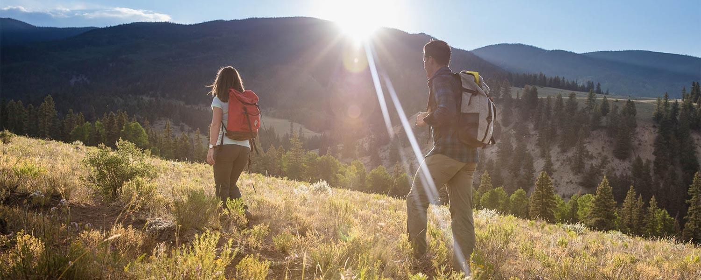Man and woman hiking at 4UR ranch