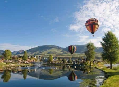 Hot air balloons over lake