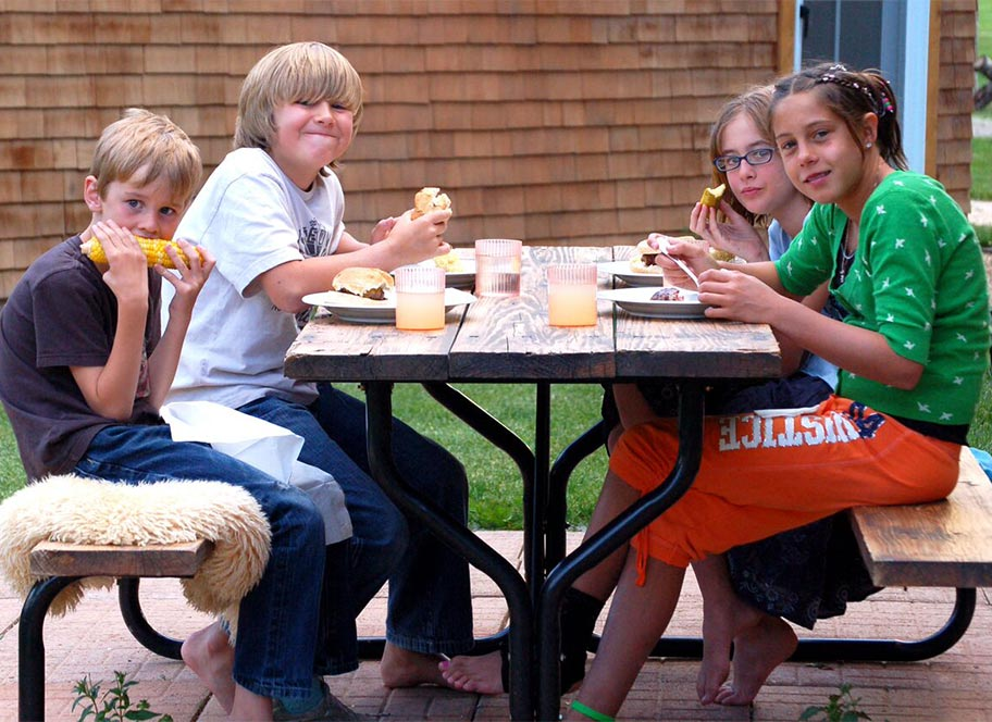 Kids dining at picnic table