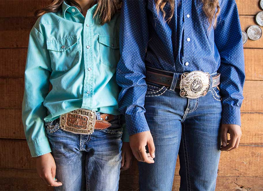 Girls wearing big Western buckles