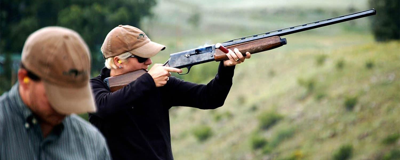 Man shooting rifle at 4UR